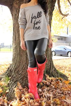 Gray oversized sweatshirt with neon coral rain boots. The perfect spring/fall statement.