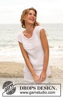 Knitted DROPS top with lace pattern and round yoke