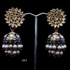 Kundan Meena Earring GROSS WT.(gm.): 39.000 GOLD WT.(gm.): 26.910 SILVER WT.(gm.): 7.440 DIA WT.(ct.): 0.000 POLKI WT.(ct.): 3.250 STONE WT.(ct.): 0.000 PEARL WT.(ct.): 20.000