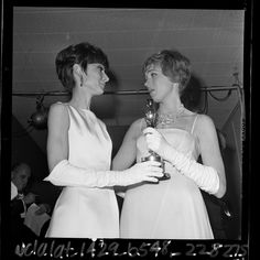 Audrey Hepburn handing Julie Andrews her best actress Oscar for Mary Poppins, 1965