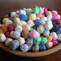 "favor idea - paper pulp ""seed bombs"" with wildflower seeds embedded in them for planting."