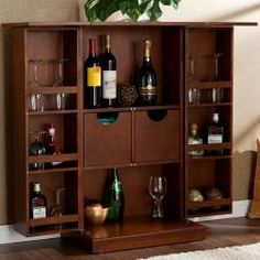 @Overstock - With fold out features, this bar provides ample storage space for your favorite bottles and specialty glasses. The fold-away bar has six shelves for displaying bottles and glassware, in addition to two drawers for less decorative items.http://www.overstock.com/Home-Garden/Trinity-Walnut-Fold-away-Bar/6787294/product.html?CID=214117 $269.99