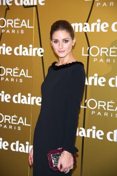 """Olivia Palermo at Marie Claire Prix de la Moda Awards 2012 in Madrid wearing a Rafe """"Dawn"""" snakeskin and shell inlay minaudière."""