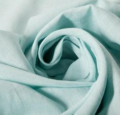 Cotton Linen Blend Blue Fabric, 145cm, £9/m, Pale sky blue. This light-weight, non-stretch fabric ideal for summer trousers, shirts and interior. Do not bleach, Machine wash, Warm iron, Tumble dry low.