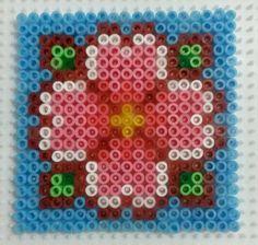 Sakura charm perler beads by CielHargreaves