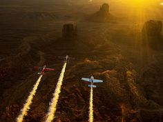 Kirby Chambliss, Nicolas Ivanoff and Matthias Dolderer fly over the Monument Valley Navajo Tribal Park in Utah as the three pilots ferry their race planes to the season finale of the Red Bull Air Race World Championship held in Las Vegas.  Joerg Mitter, European Pressphoto Agency