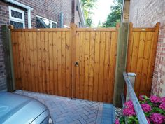 Split entrance gates - The Brentwood design. Constructed by hand using slow grown redwood pine with a medium oak finish. Backyard Gates, Garden Gates And Fencing, Driveway Landscaping, Driveway Gate, Fences, Driveway Ideas, Fence Gate, Wooden Garden Gate, Wooden Gates