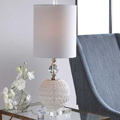 We'ave got the perfect accent decor for your home.⠀ ⠀ Mazarine Buffet Lamp by @uttermostcompany ⠀ This versatile accent lamp showcases an open ceramic basket weave design in a gloss white glaze with elegant thick crystal details and polished nickel accents. The piece is paired with a round hardback shade in a white linen fabric.  #lamp #lighting #designaccessories #interioraccessories #uttermost #design #interior4all #finedesign #interiordesign #interiorstyling #lovedesign #homedecor