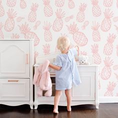 Create a modern tropical nursery with our subtle pineapple print removable wallpaper!