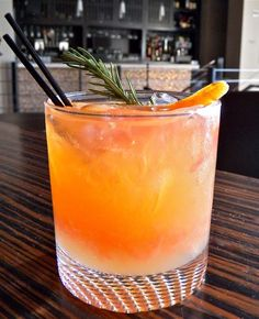 """The Whiskey Rose""— grapefruit, rye whiskey, rosemary infused honey, and more! Get the recipe here!"