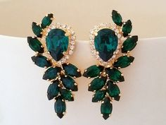 Emerald green and clear diamond Statement stud earrings, Extra large stud earrings, Swarovski crystal earrings, Bridal earrings, High fashon  Amazing, breathtaking earrings -high fashion inspired.  Measurments: 44 mm x 30 mm at the widest points (1.73 x 1.2 inches)  They are made of 14k gold plated studs and Swarovski crystals, all set in prong setting.  Made with CRYSTALLIZED™ - High quality genuine Swarovski crystals.  AVAILABLE ALSO IN SILVER PALTE VERSION. JUST CHOOSE AT METAL TYPE BOX…
