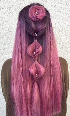 Pink hairstyle inspiration with braids, rose and mini flower hair pins