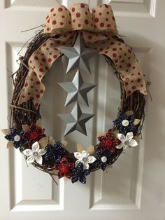 3 Star with red polka dotted burlap ribbon and red, white.  blue handmade fabric flowers  http://dreamininburlap.wix.com/dreaminwreaths