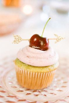 Have fun with your cupcake toppers, like this whimsical sparkly arrow. - Courtesy stylemepretty.com
