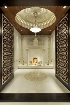 Get ideas and tips on how to make beautiful design of pooja room within a house. These pooja rooms can be created in living room, hall, bedroom or kitchen. Temple Room, Home Temple, Temple Bali, Juno Temple, Temple Design For Home, Mandir Design, Pooja Mandir, Pooja Room Door Design, Plafond Design