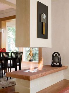 Looking to add a fireplace to your home? Check out our list of fireplaces, made from stone, tile, and other unique materials to add a welcoming and warm look to your home. These two-sided fireplaces are a luxurious touch to your living room remodel!
