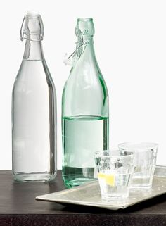Clear glass water bottle bail classic traditional French restaurant supplies waiter waitress table service outdoor rustic wedding event set tv props