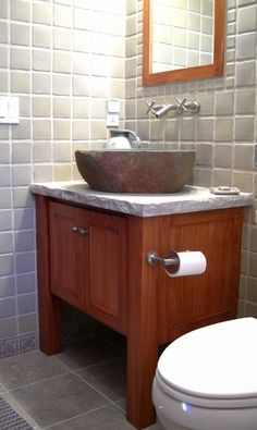 Arts and Crafts-style bathroom vanity in cypress