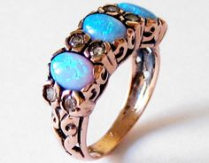 I love the color of this opal! -lace  Gold Vintage Ring with Opal