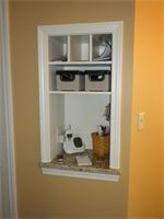built in cabinet to charge cell phones, hold mail, and place your purse.