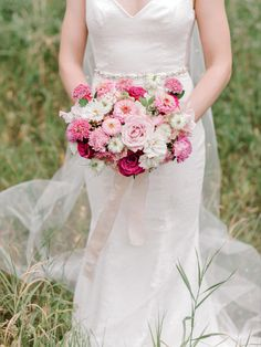 We designed this pink and white bouquet with seasonal summer blooms for our bride Khloe! She wanted small and delicate blooms so we created this for her Calgary Zoo wedding! Photo @sarah_vaughan_photography Planning @emersonandcoweddings #calgarywedding #pinkbridalbouquet #pinkweddingbouquet #summerweddingflowers #calgaryweddingflorist #flowersbyjanie #pinkzinnias #summerweddings #calgaryflorist #calgary Flower Girl Bouquet, Bridal Bouquet Pink, Bridesmaid Bouquet, Wedding Bouquets, Wedding Dresses, Bouquet Toss, Most Beautiful Flowers, Pink Summer, Calgary