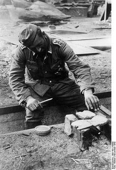 Toasting some bread inside Stalingrad, Fall 1942.
