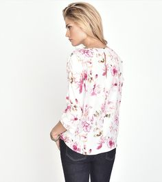Online exclusive. The secret garden. Freshen up your spring wardrobe with this petal-printed blouse.
