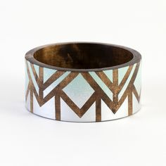 Top off any outfit with this geometric wood bangle.