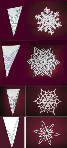 Вырезаем красивую снежинку из бумаги.