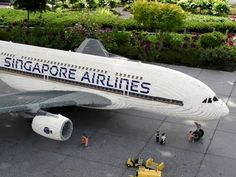 A 1:25 ratio Airbus A380, measuring 9.5ft. long with a 10.5ft. wingspan and just over three feet tall in 75,000 LEGO blocks. (Via.)