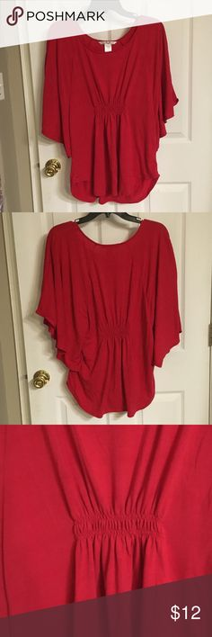 Red Batwing Top Batwing top with cinching in front and back for a fitted poncho look. Used but still in good condition. Smoke free home. Tops