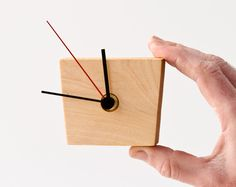 small wooden wall clock by less & more