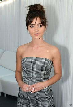 Jenna Coleman's hair pulled up in a bun with bangs. HER HAIR!