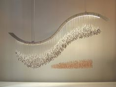 crashing wave swarovski crystal chandelierby water pressure lighting.... this one has always been one of my absolute favourites