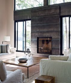 2009 - House at the Hidden Lake. Fireplace and details in hot rolled steel panels polished concrete floors white painted roughsawn wood ceilings. by basisdesignbuild Metal Fireplace, Craftsman Fireplace, Concrete Fireplace, Modern Fireplace, Fireplace Surrounds, Fireplace Design, Concrete Floors, Fireplace Doors, Fireplace Ideas