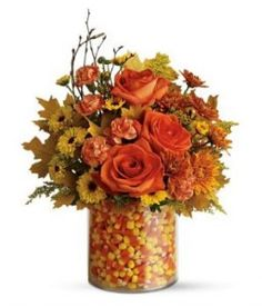 Great for a fall wedding.imagine candy corn and blooms. (make sure the flower stems are placed in a holder inside the candy corn if you are planning on eating it) also great for a fall centerpiece in your home Fall Flowers, Fresh Flowers, Orange Flowers, Bouquet Flowers, October Flowers, Kelsey Rose, Fall Floral Arrangements, Wedding Arrangements, Autumn Decorating