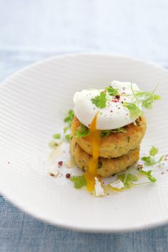 yellow lentil cakes with herbs and poached eggs