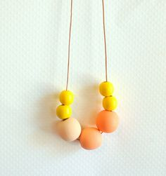 modern wood bead painted necklace - coral gradient - leather cord - fall 2012. $32.00, via Etsy.