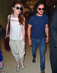 They tried to go incognito: The stars, who both come from the UK, wore sunglasses as they strolled through the busy terminal
