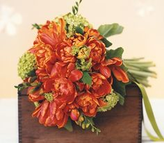 Spring bouquet of parrot tulips, freesia, and viburnum