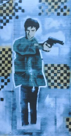 "Graffiti mural of Robert De Niro from the film Taxi Driver. Spraypainted by 3D on a wall in Park Row, Bristol in 1988. Reproduced in ""The Art Of Massive Attack"" book published in March 2014."