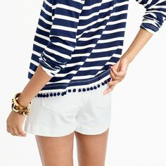 Striped T-shirt with pom-poms