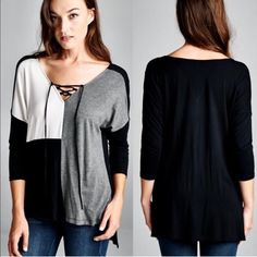 The LYNH lace up monochrome top - BLACK Colorblock monochromatic Knit top with lace up detail in front. Fabric 95% Rayon Modal 5% Spandex Made in USA Bellanblue Tops Blouses