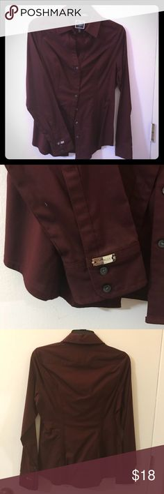 Original Ultimate Essential Shirt (S) Burgundy This shirt is fitted for a feminine silhouette, it's the shirt you need to finish a classic work look or to step up your weekend style. It has been dry cleaned only and is like new ! Express Tops Button Down Shirts