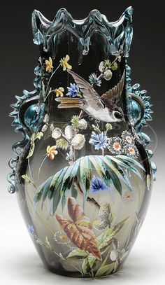 James D. Julia, Inc. -  Moser Enameled Vase. Smoke colored glass with applied blue crystal rigaree to edge of vase and wishbone decoration around top. Enameled decoration of a bird flying over a garden of flower blossoms,pods, leaves and branches