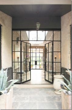 Glass doors and Courtyard... Must have green/ in the yard. <3.