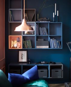 IKEA has a variety of open cabinets for wall storage like EKET cabinets. You can group the square cabinets how you want and choose from colors like light blue, dark blue and light orange. They come in singles, doubles and with four compartments.