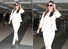 """""""Paletó Chanel também é um curinga e não tem como errar"""", relembra Gloria através do look escolhido por Miranda Kerr, que finalizou com slipper de oncinha."""