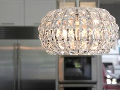 Crystal pendant lights over give this contemporary kitchen just a small touch of glam.