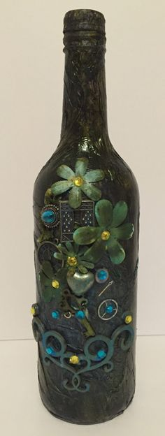 Altered bottle mixed media by MidlandCoils on Etsy